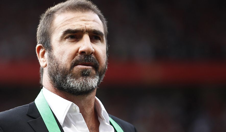 FILE - This is a Friday Aug. 5, 2011 file photo of former Manchester United soccer player Eric Cantona as he stands on the pitch before a testimonial soccer match for former Manchester United player Paul Scholes at Old Trafford Stadium, Manchester, England.   Cantona told France Inter radio Tuesday Sept. 22, 2015, that he is setting up a scheme with authorities in Marseille to lend a 50 square meter house, along with a large garden, to people fleeing war and poverty in the Middle East and Africa. (AP Photo/Jon Super, File)