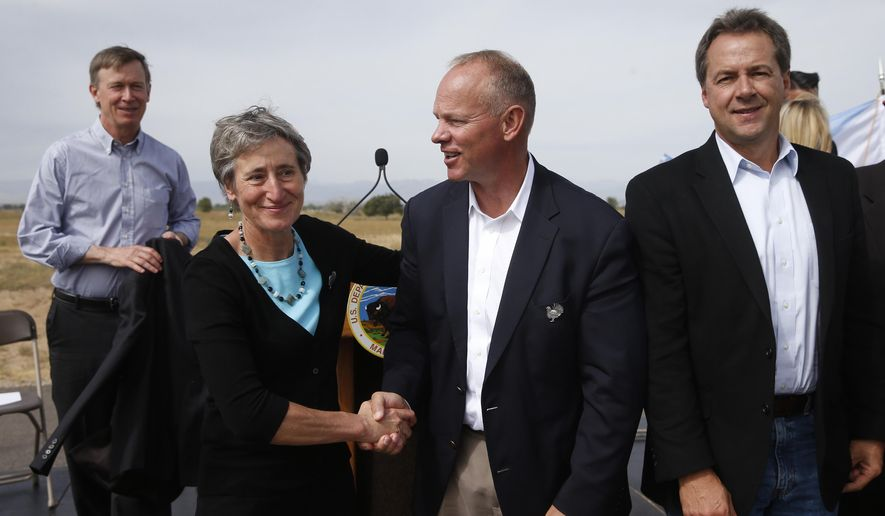 Interior Secretary Sally Jewell, second from left, shakes hands with Wyoming Gov. Matt Mead at a gathering where Secretary Jewell made the formal announcement that the greater sage grouse, a ground-dwelling bird whose vast range spans 11 Western states, does not need federal protections, at Rocky Mountain Arsenal National Wildlife Refuge, in Commerce City, Colo., Tuesday Sept. 22, 2015. At left is Colorado Gov. John Hickenlooper, and on the right is Montana Gov. Steve Bullock. The Obama administration and affected states have committed hundreds of millions of dollars to saving the grouse without Endangered Species Act protections that many argued would threaten industry. (AP Photo/Brennan Linsley)