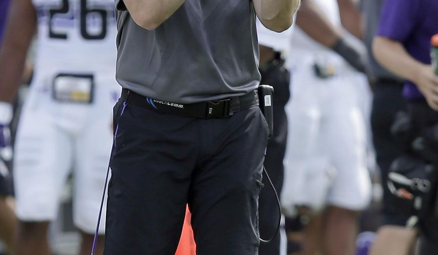 Northwestern coach Pat Fitzgerald applauds his team during the first half of an NCAA college football game against Duke in Durham, N.C., Saturday, Sept. 19, 2015. (AP Photo/Gerry Broome)