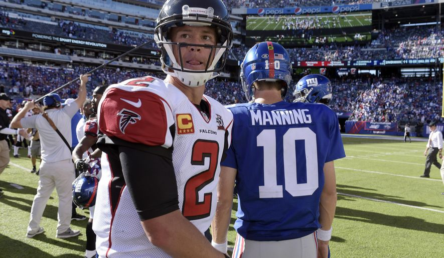 Atlanta Falcons quarterback Matt Ryan, left, walks on the field after talking to New York Giants quarterback Eli Manning after an NFL football game, Sunday, Sept. 20, 2015, in East Rutherford, N.J. The Falcons won 24-20. (AP Photo/Bill Kostroun)