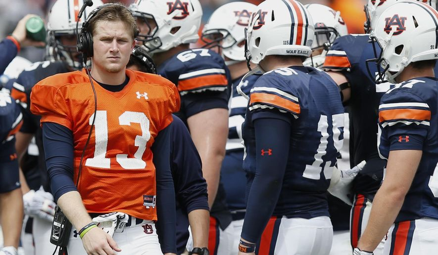 File - In this April 18, 2015, file photo, Auburn quarterback Sean White (13) walks around the field during the second half of their spring NCAA college football game in Auburn, Ala. Auburn coach Gus Malzahn said Tuesday. Sept. 22, 2015, he is benching a struggling Jeremy Johnson and switching to Sean White starting in Saturday night's game against Mississippi State. (AP Photo/Brynn Anderson, File)