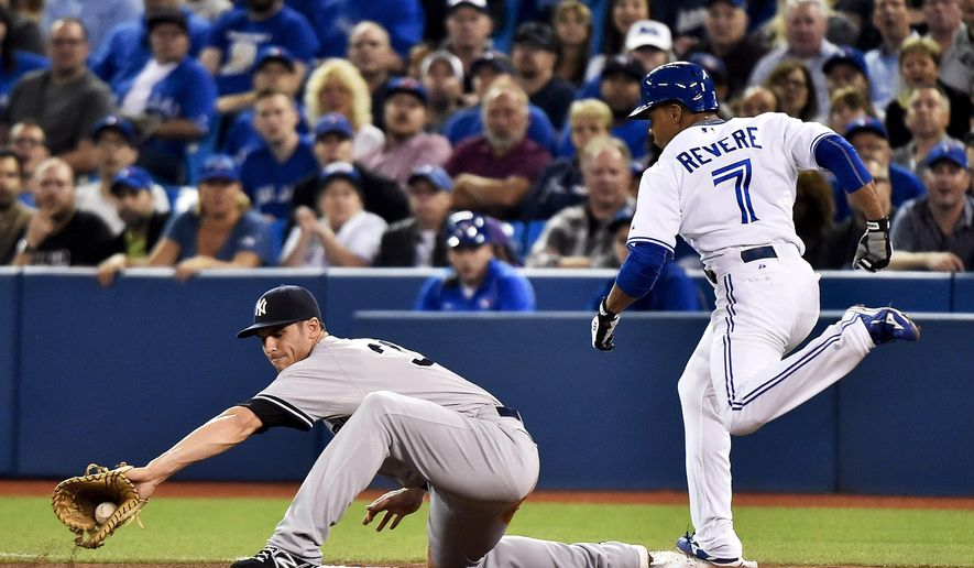 Toronto Blue Jays' Ben Revere, right, beats the throw to New York Yankees first baseman Greg Bird during the first inning of a baseball game Tuesday, Sept. 22, 2015, in Toronto. (Nathan Denette/The Canadian Press via AP) MANDATORY CREDIT