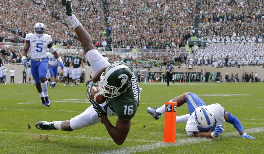 FILE - In this Saturday, Sept. 19, 2015, file photo, Michigan State's Aaron Burbridge (16) comes down with a reception for a touchdown against Air Force's Kalon Baker, right, and Dexter Walker (5) during an NCAA college football game in East Lansing, Mich.  Burbridge has emeraged as Connor Cook's top receiving target early this season, answering one crucial question about the Spartans' offense. (AP Photo/Al Goldis, File)