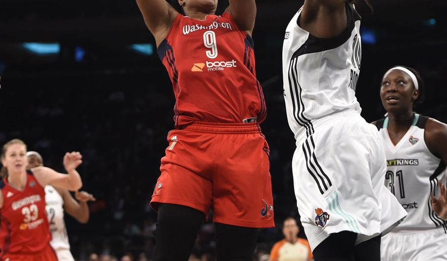 Washington Mystics center Kia Vaughn (9) shoots a basket over New York Liberty guard Epiphanny Prince (10) during the first half of Game 3 of a WNBA basketball Eastern Conference semifinal series, Tuesday, Sept. 22, 2015 in New York. (AP Photo/Kathy Kmonicek)