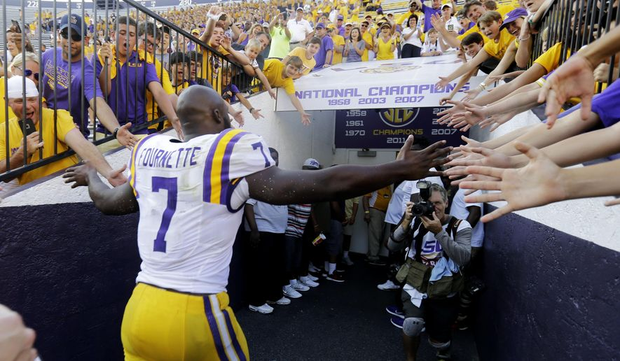 LSU running back Leonard Fournette (7) greets fans as he runs off the field after an NCAA college football game against Auburn in Baton Rouge, La., Saturday, Sept. 19, 2015. Fournette had 228 rushing yards, nine receiving yards, and three touchdowns as LSU won 45-21.  (AP Photo/Gerald Herbert)