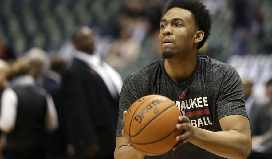 FILE - In this April 30, 2015, file photo, Milwaukee Bucks' Jabari Parker shoots baskets before Game 6 of an NBA basketball first-round playoff series against the Chicago Bulls in Milwaukee. Parker is expected to be on the floor when Bucks training camp begins next week, though the team will proceed cautiously with its star returning from a left knee injury. (AP Photo/Aaron Gash, File)