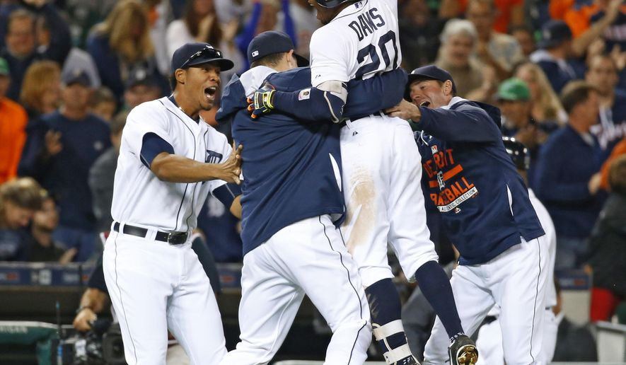 Detroit Tigers' Rajai Davis (20) celebrates his game winning one-run triple against the Chicago White Sox in the tenth inning of a baseball game in Detroit Tuesday, Sept. 22, 2015. Detroit won 2-1. (AP Photo/Paul Sancya)