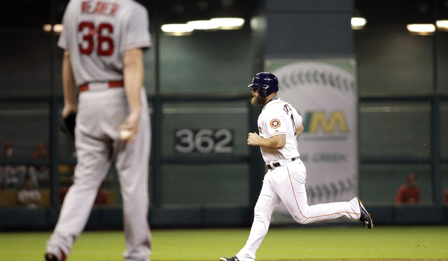 Houston Astros' Evan Gattis, right, runs the bases after hitting a two-run home run off Los Angeles Angels starting pitcher Jered Weaver (36) during the second inning of a baseball game Monday, Sept. 21, 2015, in Houston. Colby Rasmus scored on Gattis' homer. (AP Photo/David J. Phillip)