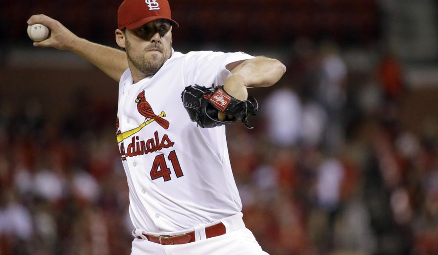 St. Louis Cardinals starting pitcher John Lackey throws during the first inning of a baseball game against the Cincinnati Reds on Tuesday, Sept. 22, 2015, in St. Louis. (AP Photo/Jeff Roberson)
