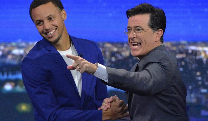 "In this photo provided by CBS, NBA MVP Stephen Curry, left, appears with host Stephen Colbert on ""The Late Show with Stephen Colbert,"" Monday, Sept. 21, 2015, on the CBS Television Network. (John Paul Filo/CBS via AP) MANDATORY CREDIT; NO ARCHIVE; NO SALES; NORTH AMERICAN USE ONLY."