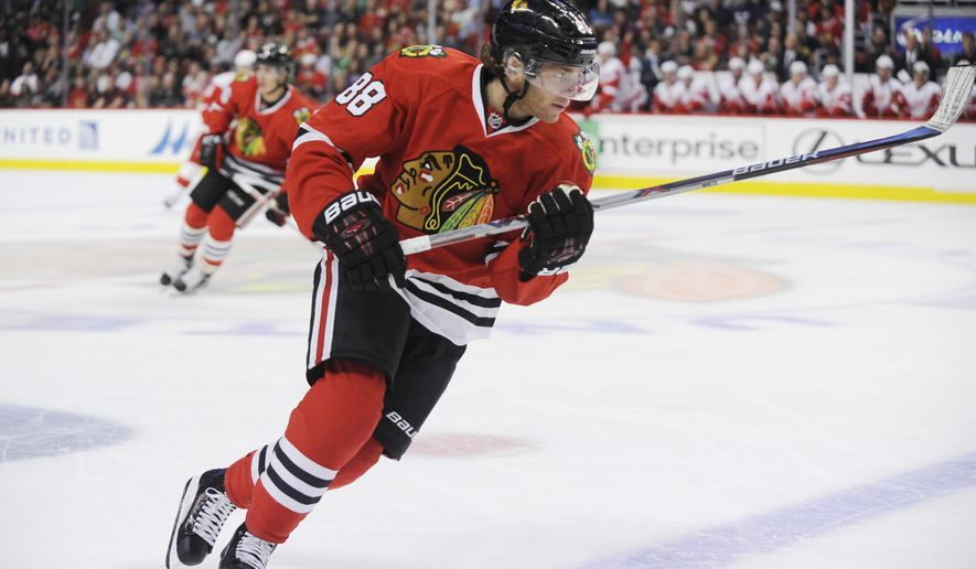 Chicago Blackhawks right wing Patrick Kane (88) chases the puck against the Detroit Red Wings in the first period of their pre-season NHL hockey game in Chicago, Tuesday, Sept. 22, 2015.  (AP Photo/David Banks)