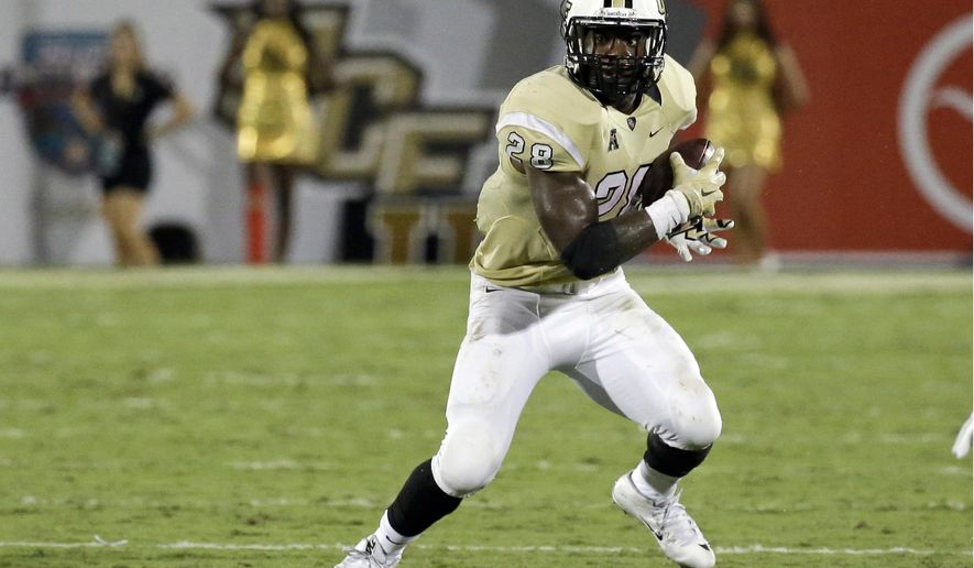 FILE - In this Sept. 3, 2015, file photo, Central Florida's William Stanback carries the ball against Florida International during the second half of an NCAA college football game in Orlando, Fla. UCF has dismissed the junior running back from the team, Tuesday, Sept. 22, 2015, citing a continuous failure to comply with athletic policy and team rules. (AP Photo/John Raoux, File)