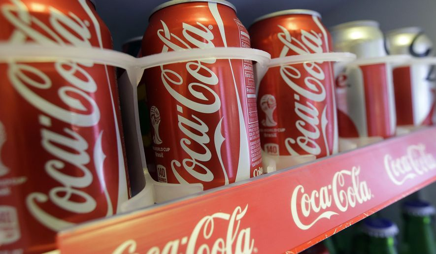 Cans of Coca-Cola sit in the refrigerator of Chile Lindo in San Francisco on June 30, 2014. (Associated Press) **FILE**
