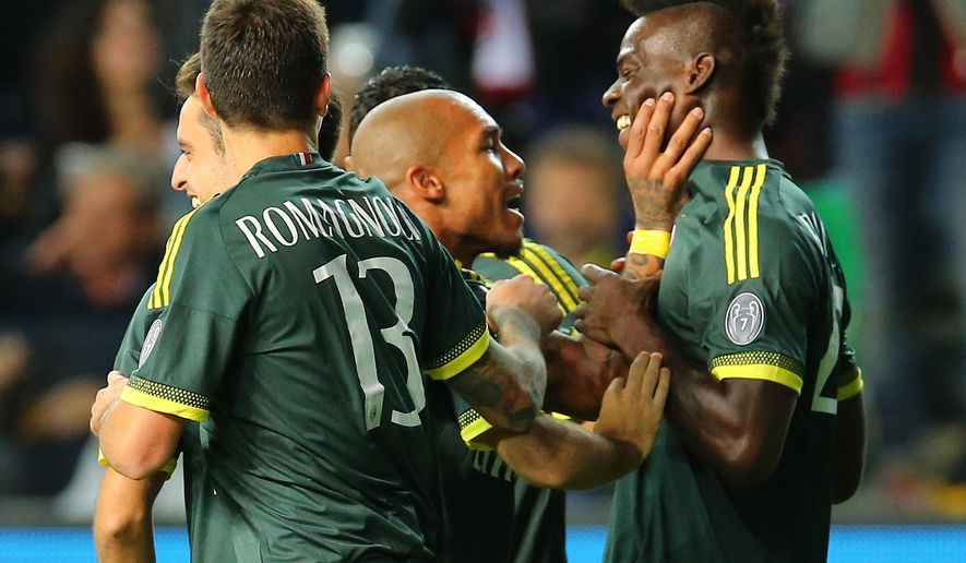 AC Milan's Mario Balotelli, right, celebrates with his Dutch teammate Nigel Dejong after scoring, during the Serie A soccer match between Udinese and AC Milan at the Friuli Stadium in Udine, Italy, Tuesday, Sept. 22, 2015. (AP Photo/Paolo Giovannini)