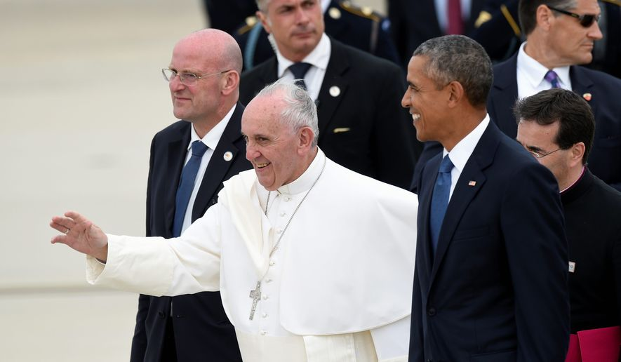 Pope Francis, center, walks with President Barack Obama, right, after arriving at Andrews Air Force Base in Md., Tuesday, Sept. 22, 2015. The Pope is spending three days in Washington before heading to New York and Philadelphia. This is the Pope's first visit to the United States. (AP Photo/Susan Walsh)