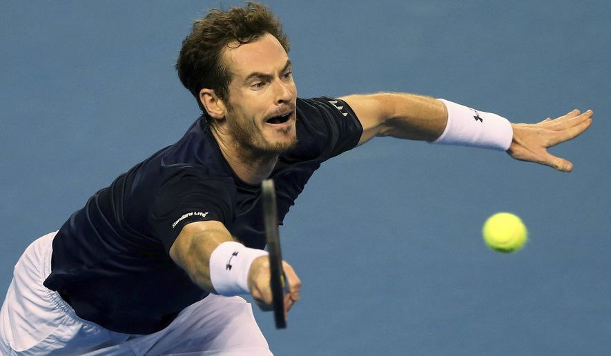 Britain's Andy Murray plays a return to Australia's Bernard Tomic during a semifinal tennis match of the Davis Cup between Britain and Australia in Glasgow, Scotland Sunday Sept. 20, 2015. (AP Photo/Scott Heppell)