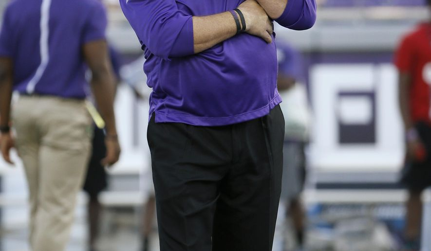 TCU head coach Gary Patterson watches his team warm up before an NCAA college football game against SMU, Saturday, Sept. 19, 2015, in Fort Worth, Texas. (AP Photo/Tony Gutierrez)