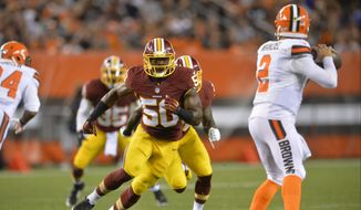 Washington Redskins outside linebacker Martrell Spaight (50) rushes Cleveland Browns quarterback Johnny Manziel (2) during an NFL preseason football game Thursday, Aug. 13, 2015, in Cleveland. Washington won 20-17. (AP Photo/David Richard)