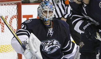 FILE - In this Dec. 18, 2010, file photo, Nashville Predators goalie Mark Dekanich (31) can't stop a shot by Los Angeles Kings left wing Ryan Smyth. Dekanich is one of 15 players demanding unpaid wages dating back months at Croatian club Medvescak Zagreb, one of 28 teams from seven countries in the Kontinental Hockey League. (AP Photo/Mark Humphrey, File)
