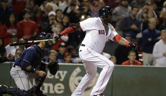 Boston Red Sox designated hitter David Ortiz, right, grounds out as Tampa Bay Rays catcher J.P. Arencibia, left, watches in the seventh inning of a baseball game, Monday, Sept. 21, 2015, at Fenway Park, in Boston. The Red Sox won 8-7. (AP Photo/Steven Senne)