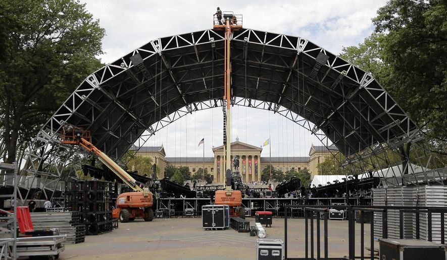 Workmen construct a stage ahead of the World Meeting of Families and Pope Francis's scheduled visit Monday, Sept. 21, 2015, in Philadelphia. Francis arrives in Philadelphia on Saturday. (AP Photo/Matt Rourke)
