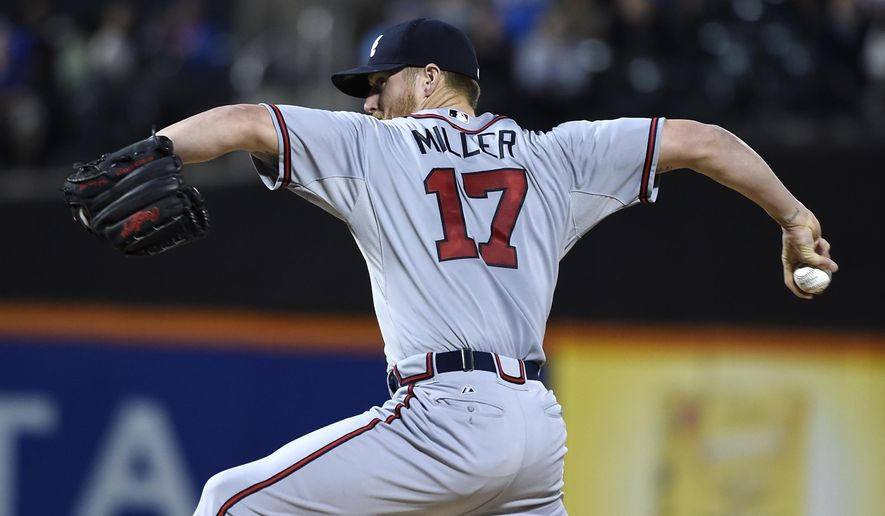 Atlanta Braves starter Shelby Miller pitches against the New York Mets in the first inning of a  baseball game, Monday, Sept. 21, 2015, in New York. The Mets won 4-0. (AP Photo/Kathy Kmonicek)
