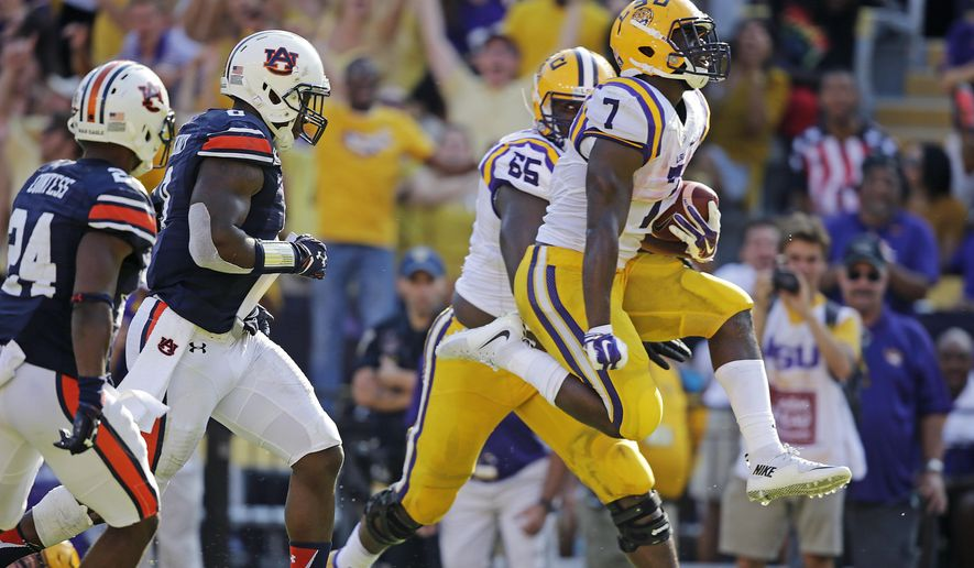 LSU running back Leonard Fournette (7) leaps into the end zone on a 29 yard touchdown carry in the second half of an NCAA college football game against Auburn in Baton Rouge, La., Saturday, Sept. 19, 2015. LSU won 45-21. (AP Photo/Gerald Herbert)