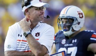 FILE - In this Saturday, Sept. 19, 2015, file photo, Auburn head coach Gus Malzahn reacts in the second half of an NCAA college football game against LSU in Baton Rouge, La. The Tigers have plenty of issues to overcome if they're going to turn this season around, extending well beyond quarterback Jeremy Johnson's struggles. They've gone from No. 6 to unranked in two weeks.  (AP Photo/Gerald Herbert, File)