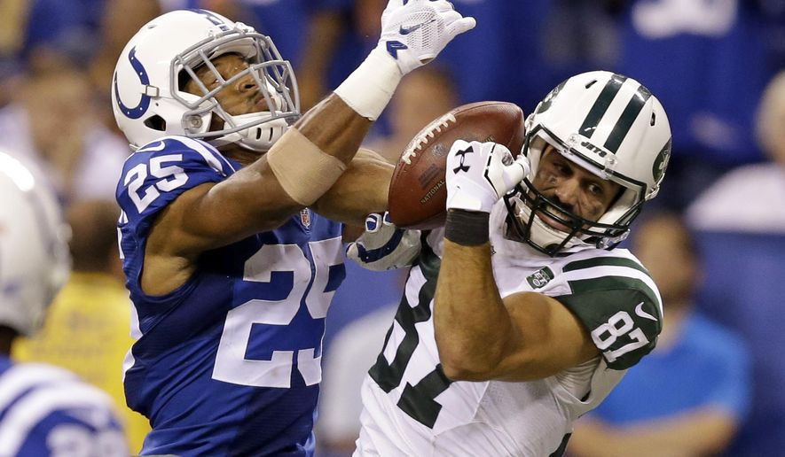 New York Jets wide receiver Eric Decker (87) and Indianapolis Colts defensive back Jalil Brown (25) battle for the ball in the second half of an NFL football game in Indianapolis, Monday, Sept. 21, 2015. The pass was incomplete. (AP Photo/Darron Cummings)