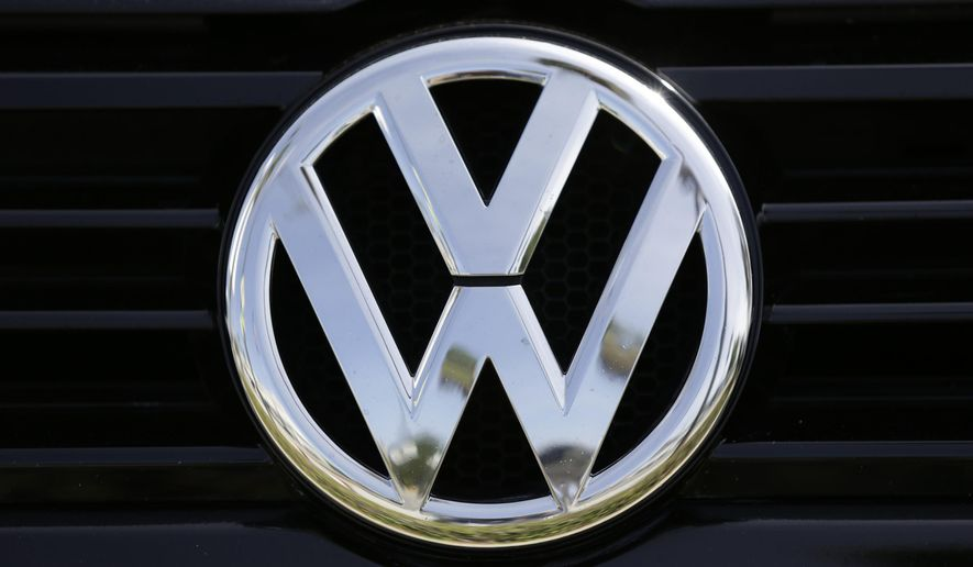 The Volkswagen logo is seen on car offered for sale at New Century Volkswagen dealership in Glendale, Calif., Monday, Sept. 21, 2015. Volkswagen shares plunged Monday after U.S. regulators accused the German automaker of cheating on emissions tests, alleging that nearly 500,000 cars weren't meeting federal standards. (AP Photo/Damian Dovarganes)