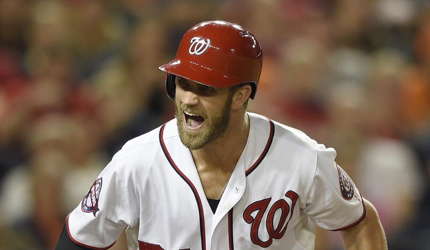 Washington Nationals' Bryce Harper reacts after popping out during the third inning of a baseball game against the Baltimore Orioles, Tuesday, Sept. 22, 2015, in Washington. (AP Photo/Nick Wass)