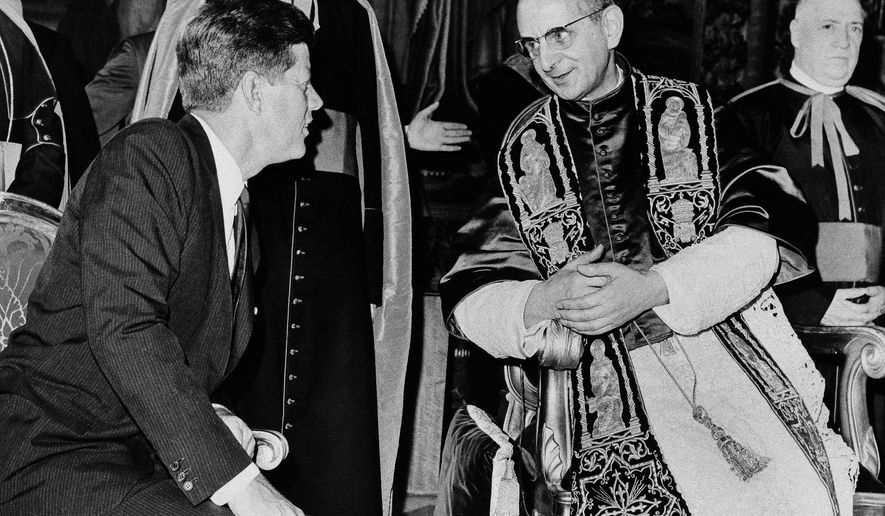 ** FILE ** President John F. Kennedy and Pope Paul VI talk at the Vatican in this July 2, 1963 file photo. Kennedy's meeting with Pope Paul VI at the Vatican was historic: the first Roman Catholic president of the United States was seeing the Roman Catholic pontiff only days after his coronation. Kennedy _ who struggled against anti-Catholic bias during his presidential campaign _ only shook hands with the pope rather than kissing his ring, as is the usual practice for Catholics.  (AP Photo/File)