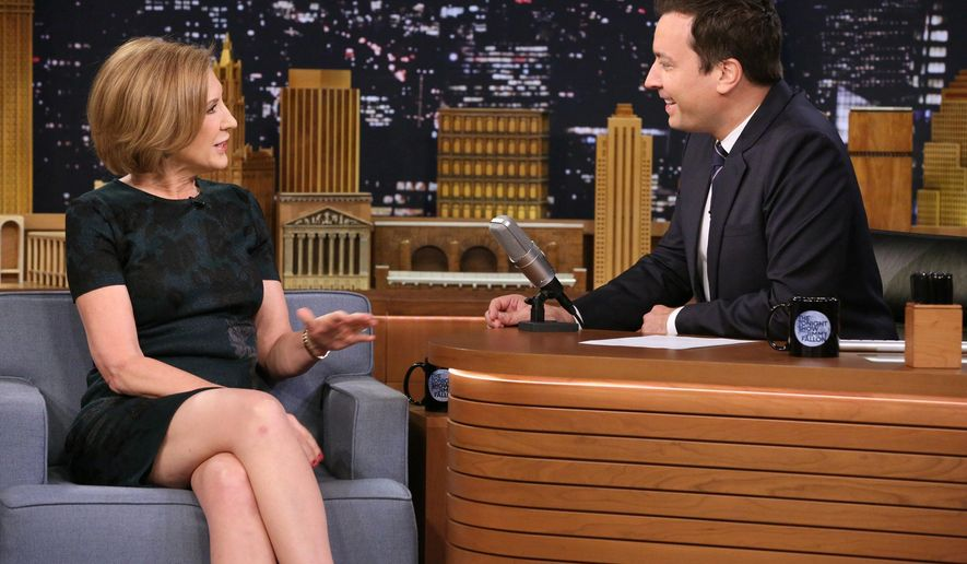 """In this image released by NBC, Republican presidential candidate Carly Fiorina, left, appears with host Jimmy Fallon during a taping of """"The Tonight Show with Jimmy Fallon,"""" on Monday, Sept. 21, 2015, in New York. (Douglas Gorenstein/NBC/NBCU Photo Bank via AP)"""