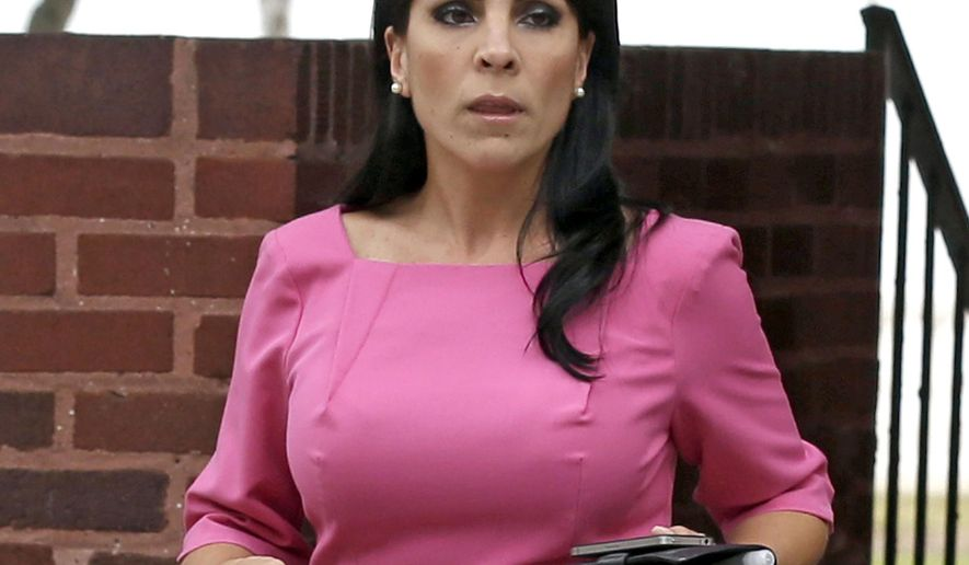 FILE - In this Nov. 13, 2012, file photo, Jill Kelley leaves her home in Tampa, Fla. Nine journalists were issued subpoenas Tuesday, Sept. 22, 2015, as part of a lawsuit over the Obama administration investigation that led to the resignation of CIA Director David Petraeus. The Jill and Scott Kelley sued the federal government in 2013, alleging that officials violated the U.S. Privacy Act by disclosing information about the couple. Jill Kelley was implicated in 2012 scandals involving Petraeus and Marine Gen. John R. Allen. (AP Photo/Chris O'Meara, File)