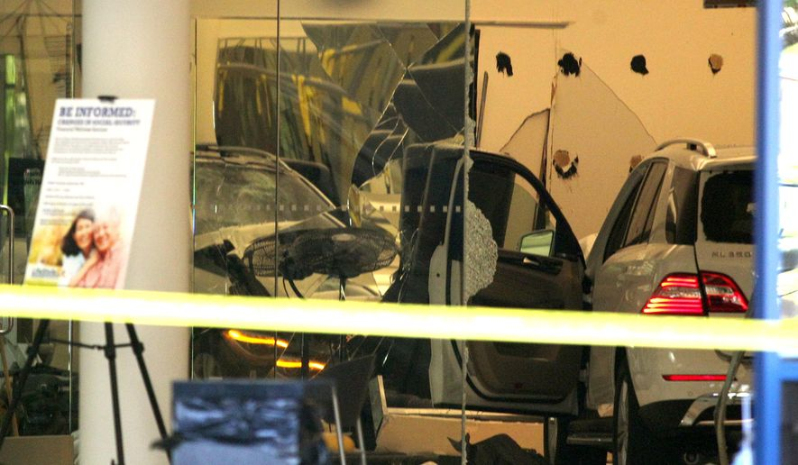 A vehicle sits inside a health club after a motorist crashed through the doors, in Livermore, Calif., on Tuesday, Sept. 22, 2015. An 80-year-old driver accidentally hit the gas pedal instead of the brake Tuesday before plowing through the doors of a Northern California health club, killing one person and injuring five others, police said.    (Anda Chu/Bay Area News Group via AP)