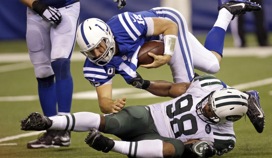 New York Jets outside linebacker Quinton Coples (98) sacks Indianapolis Colts quarterback Andrew Luck (12) in the second half of an NFL football game in Indianapolis, Monday, Sept. 21, 2015. (AP Photo/AJ Mast)