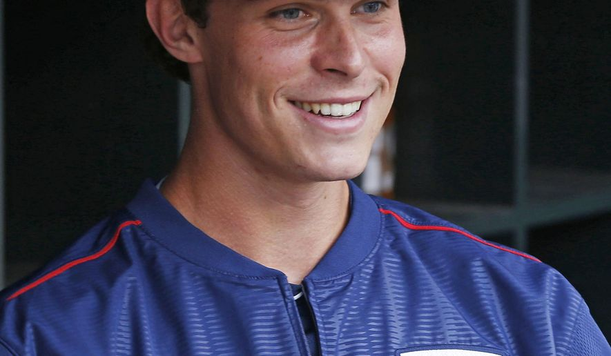 Minnesota Twins' Max Kepler smiles in the dugout during batting practice before a baseball game against the Cleveland Indians, Tuesday, Sept. 22, 2015, in Minneapolis. Kepler, who was promoted from Double-A, joined the wild card-chasing Twins Tuesday, a day after he helped lead Chattanooga to the Southern League championship. (AP Photo/Jim Mone)