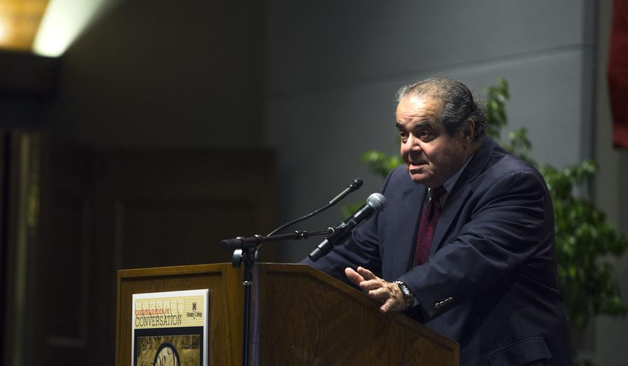 """U.S. Supreme Court Justice Antonin Scalia addresses an audience at Rhodes College, Tuesday, Sept. 22, 2015 in Memphis, Tenn. Justice Scalia's 2015 Constitution Day lecture is called """"Constitutional Interpretation."""" (Yalonda M. James/The Commercial Appeal via AP)"""