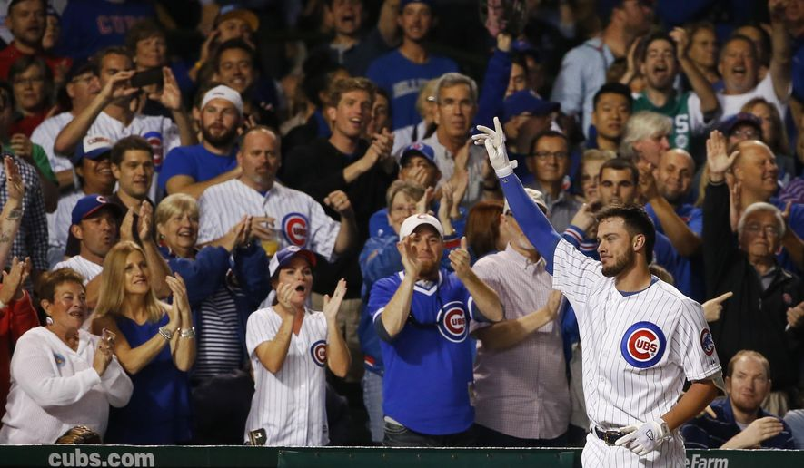 Chicago Cubs' Kris Bryant takes the curtain call after hitting a two-run home run off Milwaukee Brewers starting pitcher Tyler Cravy, also scoring Kyle Schwarber, during the third inning of a baseball game Tuesday, Sept. 22, 2015, in Chicago. (AP Photo/Charles Rex Arbogast)
