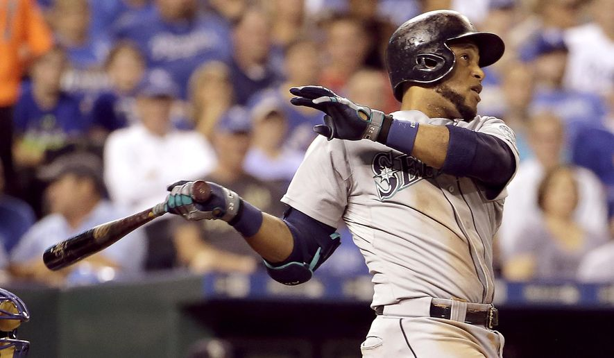Seattle Mariners' Robinson Cano hits a three-run home run during the third inning of a baseball game against the Kansas City Royals, Tuesday, Sept. 22, 2015, in Kansas City, Mo. (AP Photo/Charlie Riedel)