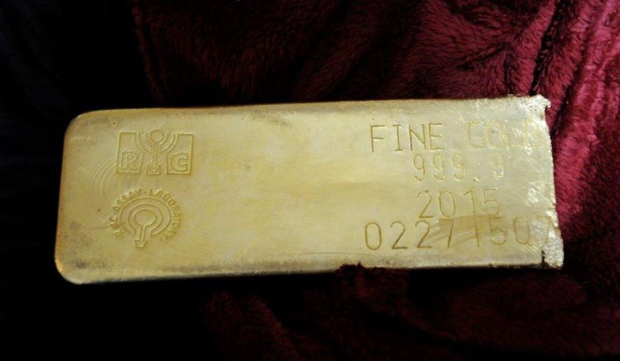 This undated photo provided by the FBI shows a gold bar that was recovered in Miami from a heist in North Carolina on March 1, 2015. Miguel Bover was sentenced to more than three years in prison in federal court in Miami, Tuesday Sept. 22, 2015, for his involvement in the attempted sale of a gold bar stolen in a $4.8 million North Carolina truck heist. The theft remains unsolved. (FBI via AP)