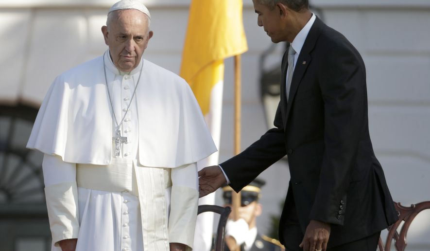 President Barack Obama guides Pope Francis to his chair during a state arrival ceremony on the South Lawn of the White House in Washington, Wednesday, Sept. 23, 2015. (AP Photo/Pablo Martinez Monsivais)