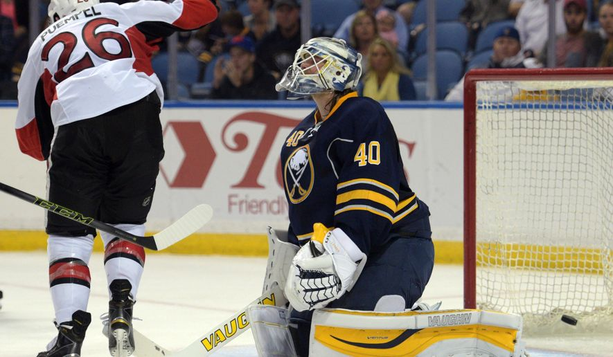 Ottawa Senators left winger Matt Puempel (26) celebrates a goal by Alex Chiasson while Buffalo Sabres goaltender Robin Lehner (40) reacts during the second period of an NHL preseason hockey game Wednesday, Sept. 23, 2015 in Buffalo, N.Y. (AP Photo/Gary Wiepert)