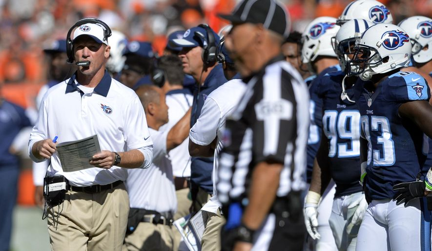 Tennessee Titans head coach Ken Whisenhunt, left, watches during the second half of an NFL football game against the Cleveland Browns, Sunday, Sept. 20, 2015, in Cleveland. (AP Photo/David Richard)