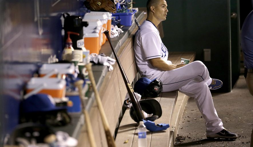 Kansas City Royals starting pitcher Jeremy Guthrie sits in the dugout after coming out of the game during the third inning after giving up nine runs to the Seattle Mariners, Tuesday, Sept. 22, 2015, in Kansas City, Mo. (AP Photo/Charlie Riedel)