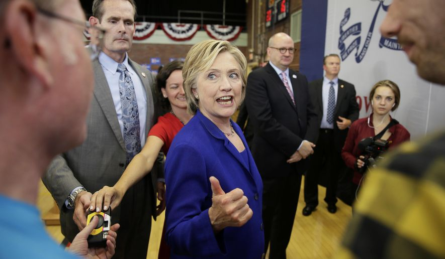 Democratic presidential candidate Hillary Rodham Clinton greets audience members following a community forum on healthcare, Tuesday, Sept. 22, 2015, at Moulton Elementary School in Des Moines, Iowa. (AP Photo/Charlie Neibergall)