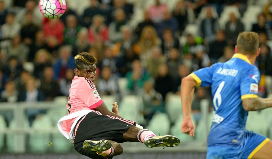 Juventus'  Paul Pogba jumps for the ball  during a Serie A soccer match between Juventus and Frosinone at the Juventus stadium, in Turin, Italy, Wednesday, Sept. 23, 2015. (AP Photo/ Massimo Pinca)