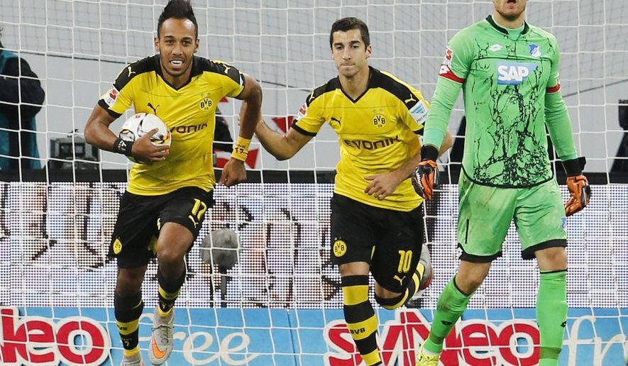 Dortmund's Pierre-Emerick Aubameyang, left, celebrates his side's equalizing goal, during a German Bundesliga soccer match between TSG 1899 Hoffenheim and Borussia Dortmund in Sinsheim, Germany, Wednesday, Sept. 23, 2015. (AP Photo/Michael Probst)