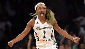 New York Liberty guard Candice Wiggins celebrates after making a 3-point basket against the Washington Mystics during the second half of Game 3 of the WNBA basketball Eastern Conference semifinal series, Tuesday, Sept. 22, 2015 in New York. Liberty won 79-74. (AP Photo/Kathy Kmonicek)