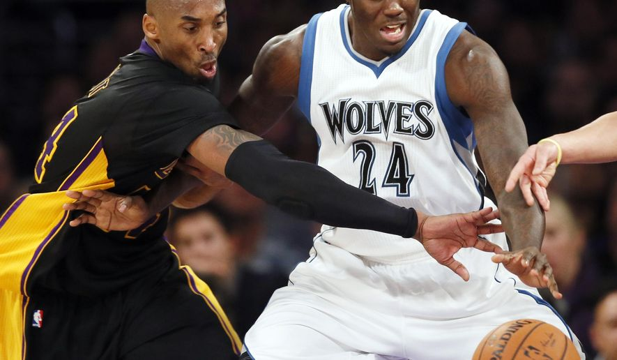 FILE - In this Nov. 28, 2014, file photo, Los Angeles Lakers' Kobe Bryant, left, and Minnesota Timberwolves' Anthony Bennett battl for the ball during the second half of an NBA basketball game in Los Angeles. If Bennett clears waivers as expected, the Timberwolves have agreed to a $3.65 million buyout of his contract, a person with knowledge of the situation told The Associated Press on Wednesday, Sept. 23, 2015. The person spoke on condition of anonymity because the buyout has not been announced. He was  surprise No. 1 overall pick by the Cleveland Cavaliers in the 2013 draft.(AP Photo/Danny Moloshok, File)